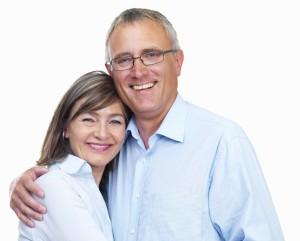 Closeup of a happy senior couple looking at camera